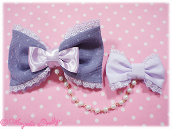 Join a couple of bows with lace, string of beads or ribbons. (Image courtesy of Angelic Pretty).
